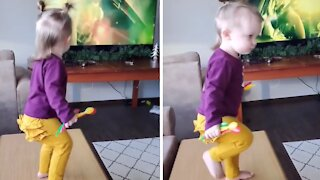 This toddler is most definitely a future metalhead