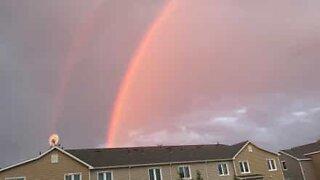Double rainbow illuminates midnight sky in Alaska!