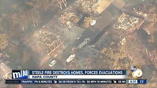 Steele fire destroys homes, forces evacuations
