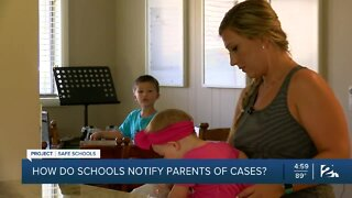 How do schools notify parents about COVID-19 cases?