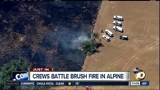 Crews battle brush fire in Alpine
