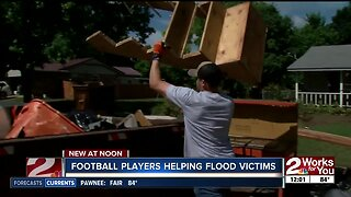 Charles Page High School's football team helps flood victims