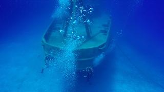 Divers explore Kittiwake shipwreck on Grand Cayman Island