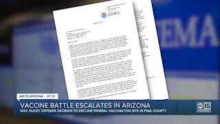 Vaccine battle escalates in Arizona