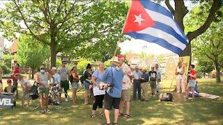 Demonstrators rally at Mitchell Park demanding an end of the Cuban embargo