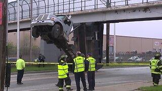 Dump truck hits pedestrian bridge on I-77 near Pershing Avenue