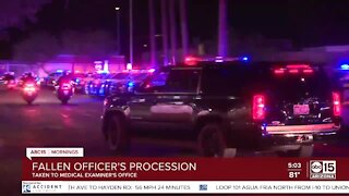 Officers escort body of officer killed in crash to medical examiner