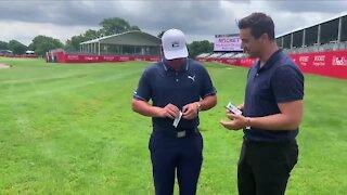 Bryson DeChambeau opens Upper Deck Artifacts golf cards with WXYZ's Brad Galli