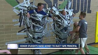 HONOR STUDENTS RAISE MONEY TO DUCT TAPE PRINCIPAL