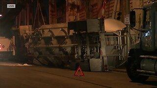 Crews clean up overturned semi-truck near Michigan Avenue Bridge