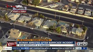 Woman arrested after barricade situation