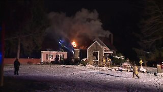 3 Norton police officers rescue 2 people from house fire that left 1 dead