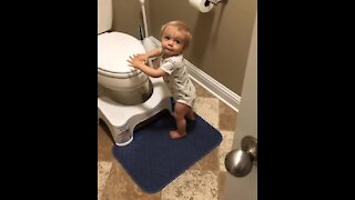 Baby boy shuts bathroom door for privacy