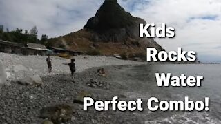 kids playing on rocky beach in Philippines