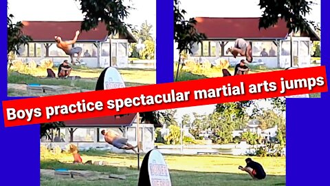 Young practice spectacular martial arts jumps
