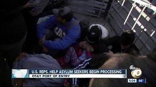 U.S. congressional delegation help asylum seekers begin processing