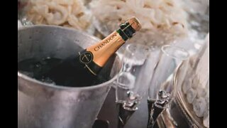 A subtle way of opening a bottle of champagne