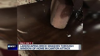 Large landscaping brick thrown through living room window narrowly misses Canton man
