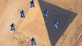 Amazing footage of skydivers free-falling over pyramids
