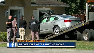 Driver dies after car crashes into Spring Hill home