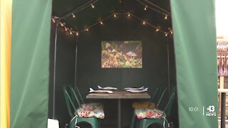 Esther's Kitchen repurposes dining tents to display art