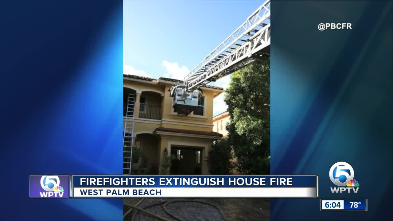 Firefighters extinguish house fire in West Palm Beach