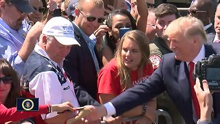 President Trump signs shoes, takes selfies with supporters