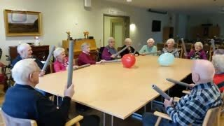 Elderly People Play with Balloons