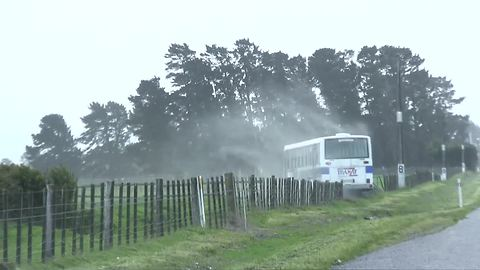 Extreme winds in New Zealand push school bus off road
