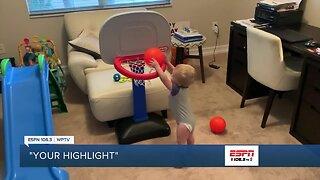Miles dunks a basketball