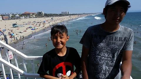 Happiness boys from Siberian in Santa Monica beach