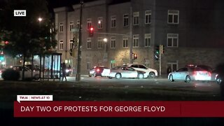 Protesters gather past curfew at 27th and Center