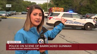 Barricaded gunman remains armed, inside home on city's west side