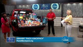 Larry H Miller and Pack A Backpack