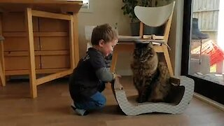 Baby boy loves to play with kitty best friend