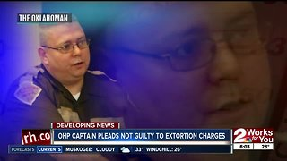 OHP captain pleads not guilty to extortion charges