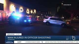 Officers open fire at arrestee armed with gun