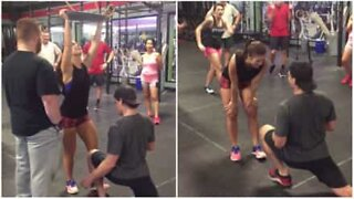 Emotional marriage proposal at the gym