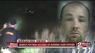 Manhunt underway for man accused of running over police officer