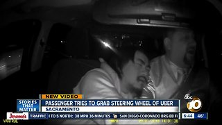 Video shows passenger trying to grab steering wheel from Uber driver
