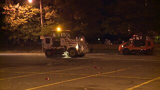 Crews clean up Muni Lot after home opener
