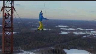 Daredevil slacklines between Russia's highest tower