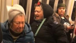 Unhinged elderly woman yells for seat in subway