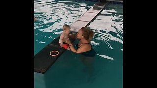 8-Month-Old Baby Learns To Swim On His Back