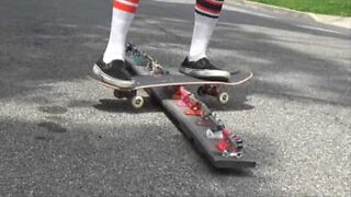 Skater grinds on skateboard parts