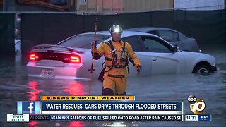Drivers rescued from flood waters