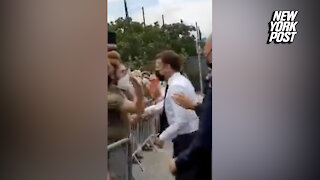French president Macron smacked in the face while greeting constituents