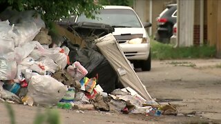 Resident in Park Hill angered by mounds of trash in neighborhood alley