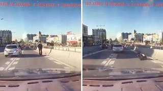 Lucky pedestrian narrowly avoids being run over after falling off Segway into oncoming traffic