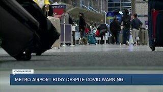 Metro airport busy despite COVID warning
